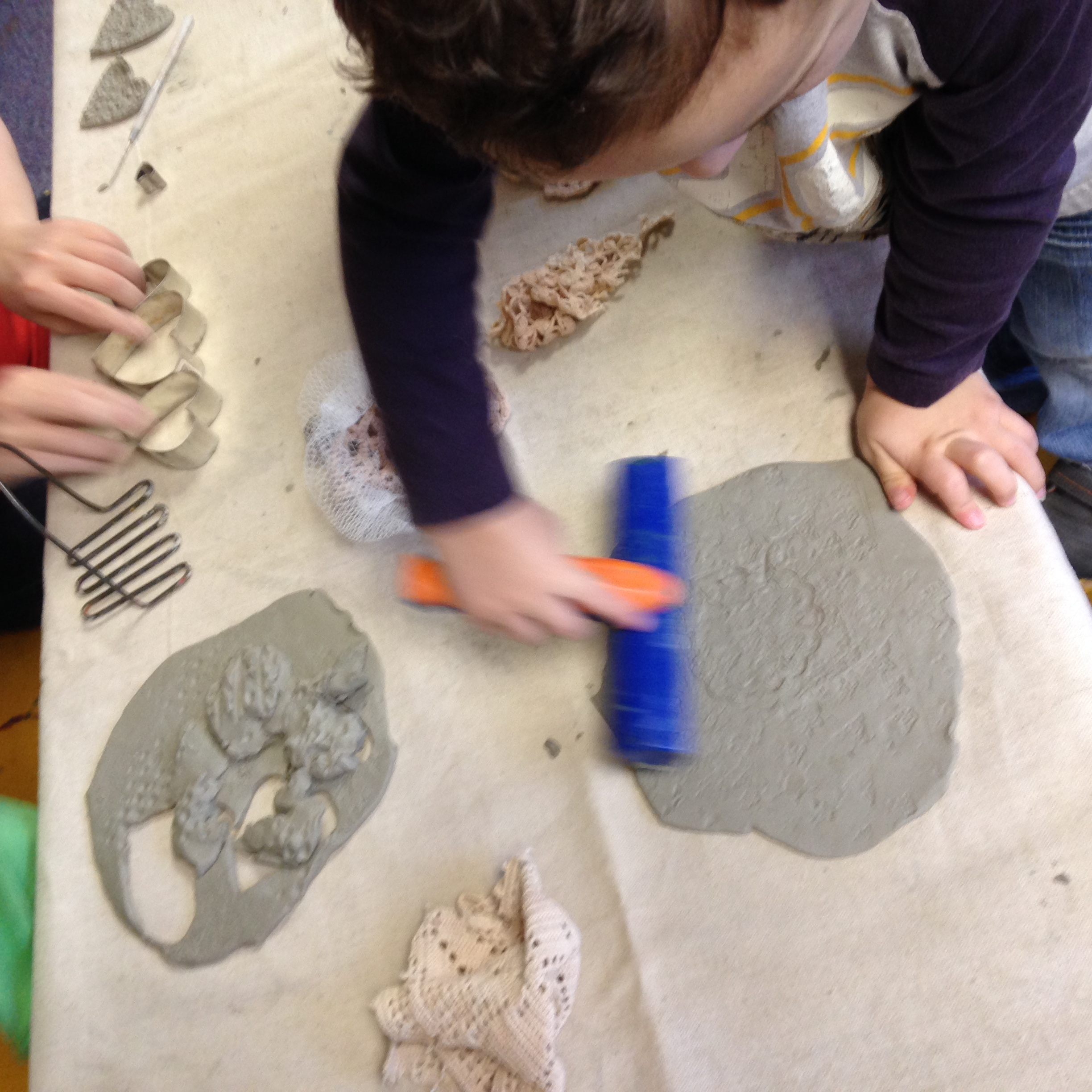 We used a wide variety of tools to impress textures into clay, exploring the effect of different tools.
