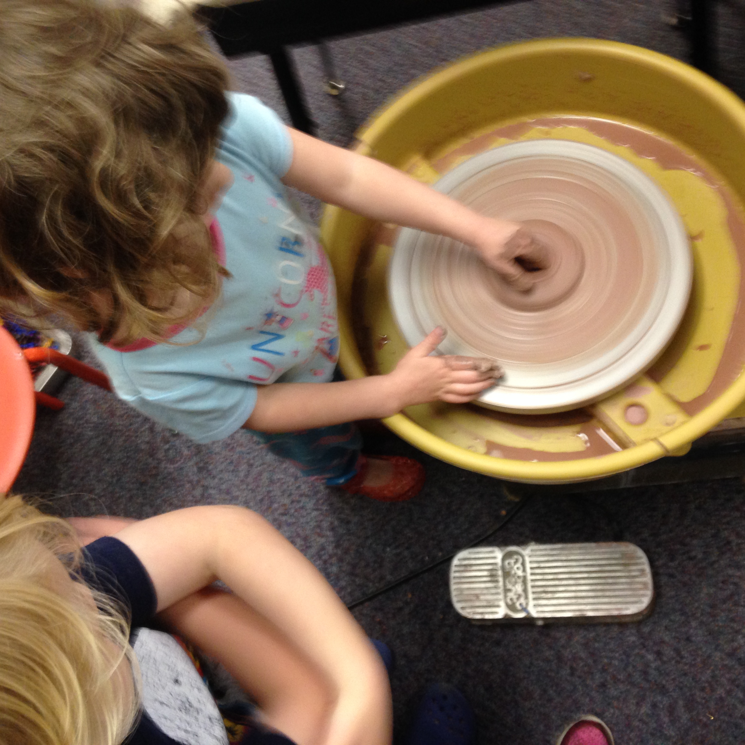 We got started on the pottery wheel, building up layers for volcanos.