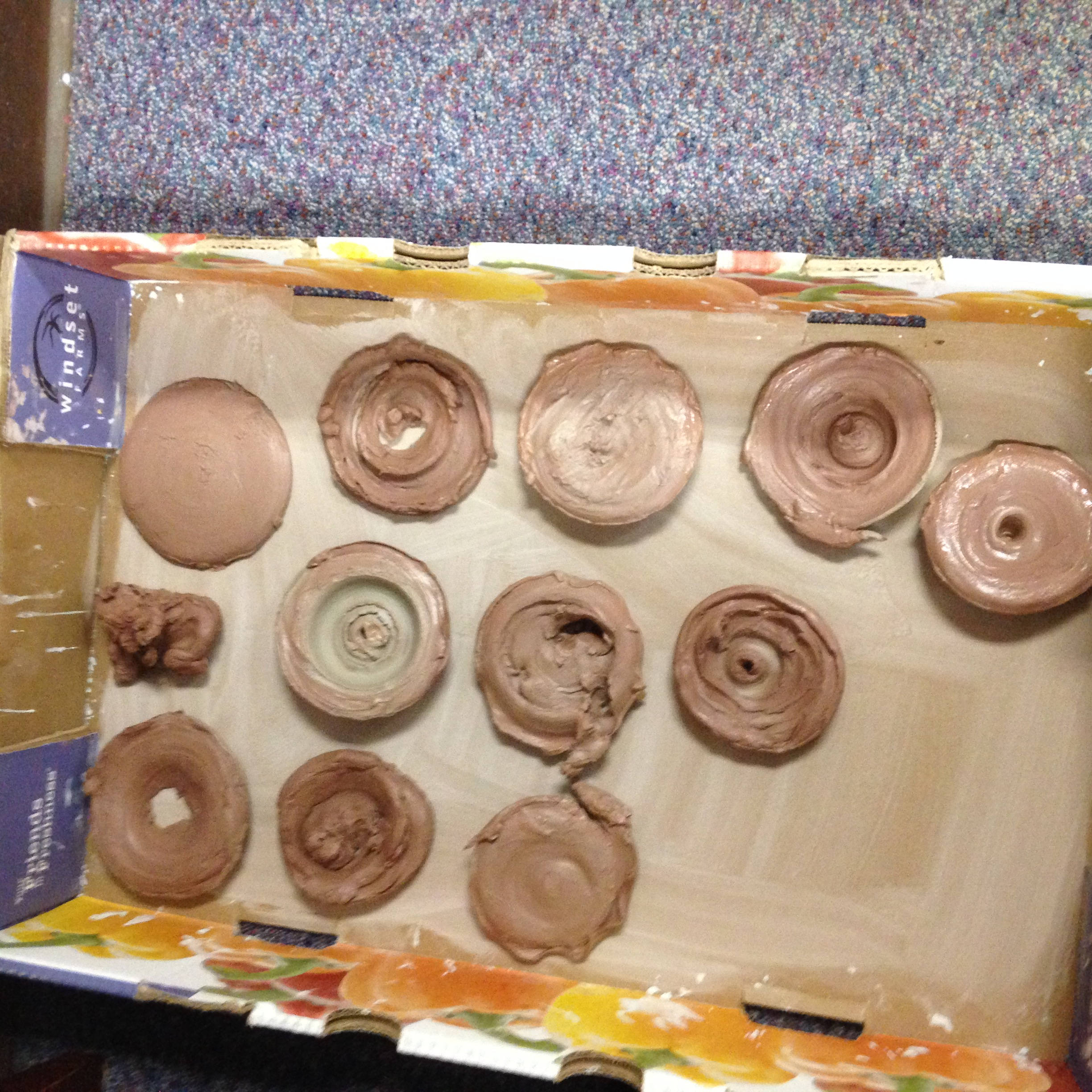 Ready for the kiln!  The kids made some really fantastic art on the pottery wheel.
