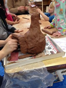 Shaping the tail and sculpting details of the head was work for older kids, while younger sculptors focused on textures and softening more clay.